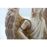 Archangel Michael statue seconds Archangel Michael statue in antique ivory finish The details are perfect on this statue but the arms have lines where they have been joined to the main statue . Please Click the image for more information.