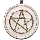 Golden pentagram on silver pendent on black cord..