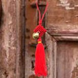Bell and Tassell for door hanging Litttle brass bell attached to a red or black tassell to hang on door knobs to symbolise protection and good fortuneT. Please Click the image for more information.