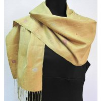 Golden silk shawl with subtle lozenge motifs Hand loomed gold silk shawl with subtle lozenge motifs  This shawl is an example of the finely crafted Laos silk weaving from the weaving stduio of Phaeng Mai. Please Click the image for more information.