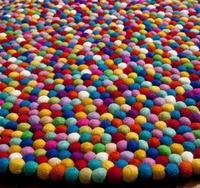 150cm Felt Ball Rug This gorgeous big freckle rug is hand made with each 2cm felt ball individually rolled and then sewn together to make the big freckle rug. Please Click the image for more information.