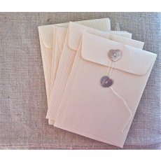 10 pack small cream envelopes (pearl shell button)