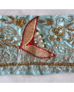 Fabric Trim in Blue This vintage ribbon fabric trim has been cut from an aqua blue satin silk vintage saree  It has been hand embroidered with metallic threads and very lovely beadwork  . Please Click the image for more information.