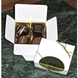 White box - 4 chocolates $8.50 Contains 4 chocolates of your choice see The Menu or a ready made assortment Please indicate your choice in the CARD MESSAGE box which is situated at Step 2 of the order process Eac. Please Click the image for more information.