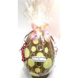 Hollow milk chocolate art egg 215mm high $39.00 Milk Chocolate with white chocolate designs Designs vary images are examples only Made using the same quality chocolate that we use in all our chocolates. Please Click the image for more information.